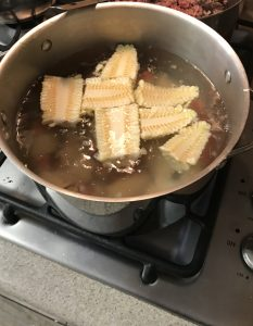 Boiling corn and potatoes